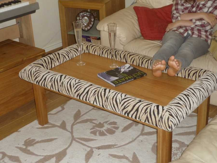 Light oak coffee table with Padable footrest in use