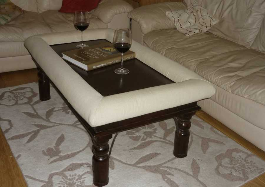 Dark teak coffee table with Padable footrest